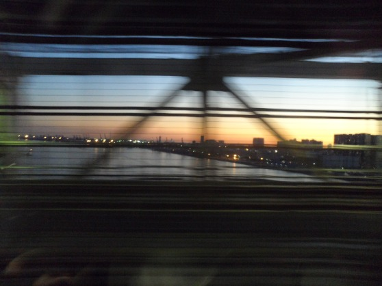 Train from Shimbashi Station heading towards Odaiba in the sunset.